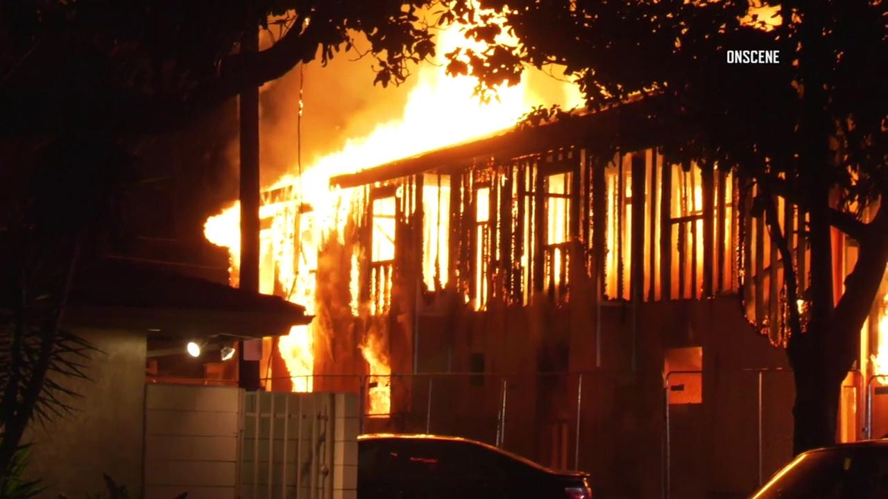 A fire engulfed two buildings that were under construction in the Green Meadows neighborhood of South Los Angeles, prompting a massive response from firefighters.