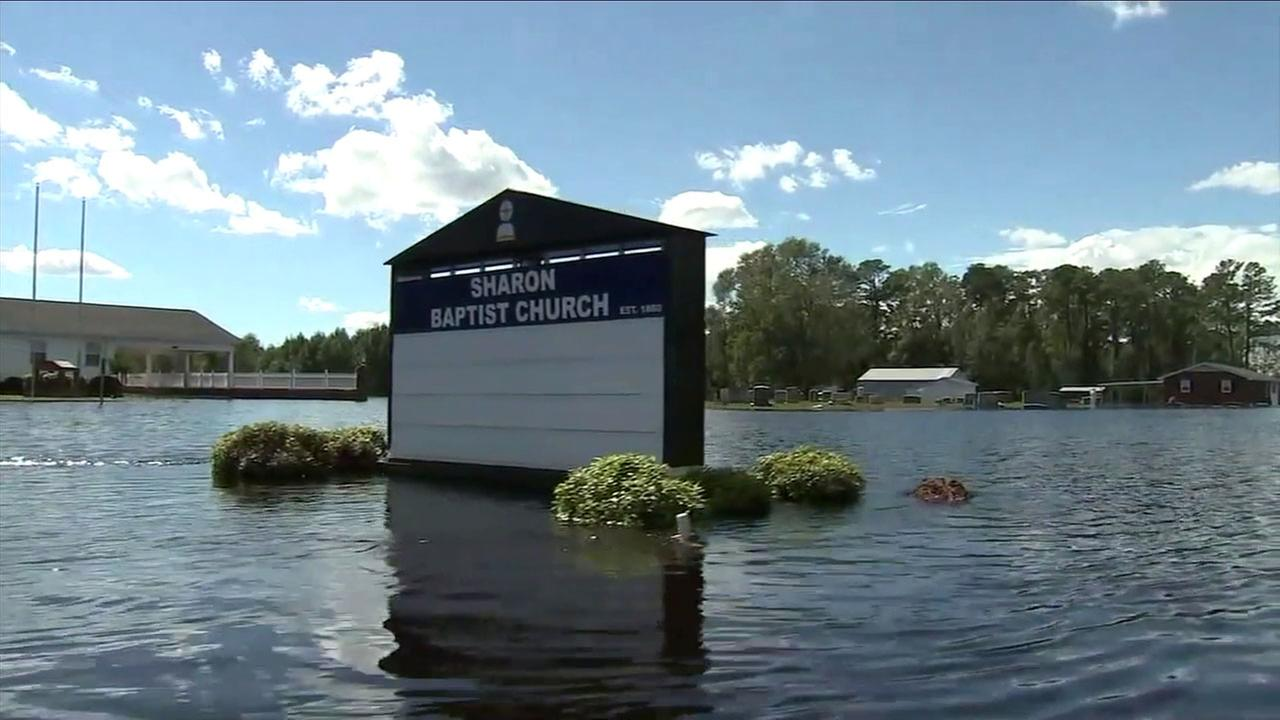 Flood waters from Florence covered streets and filled the first level of homes and churches in Chinquapin, North Carolina.