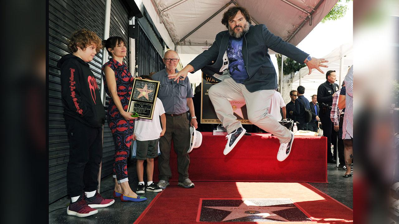 Actor Jack Black leaps over his new star on the Hollywood Walk of Fame, Tuesday, Sept. 18, 2018.