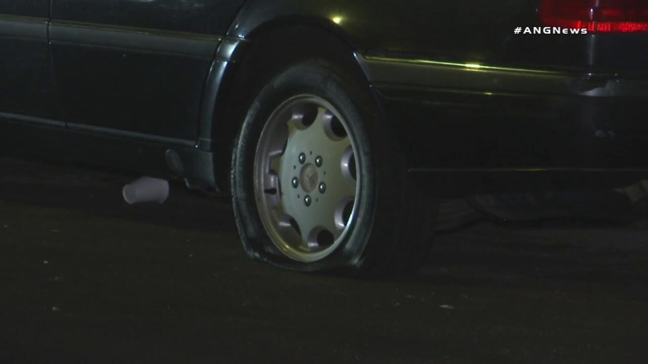 A woman was arrested after tires on at least 20 vehicles were slashed in Jefferson Park.