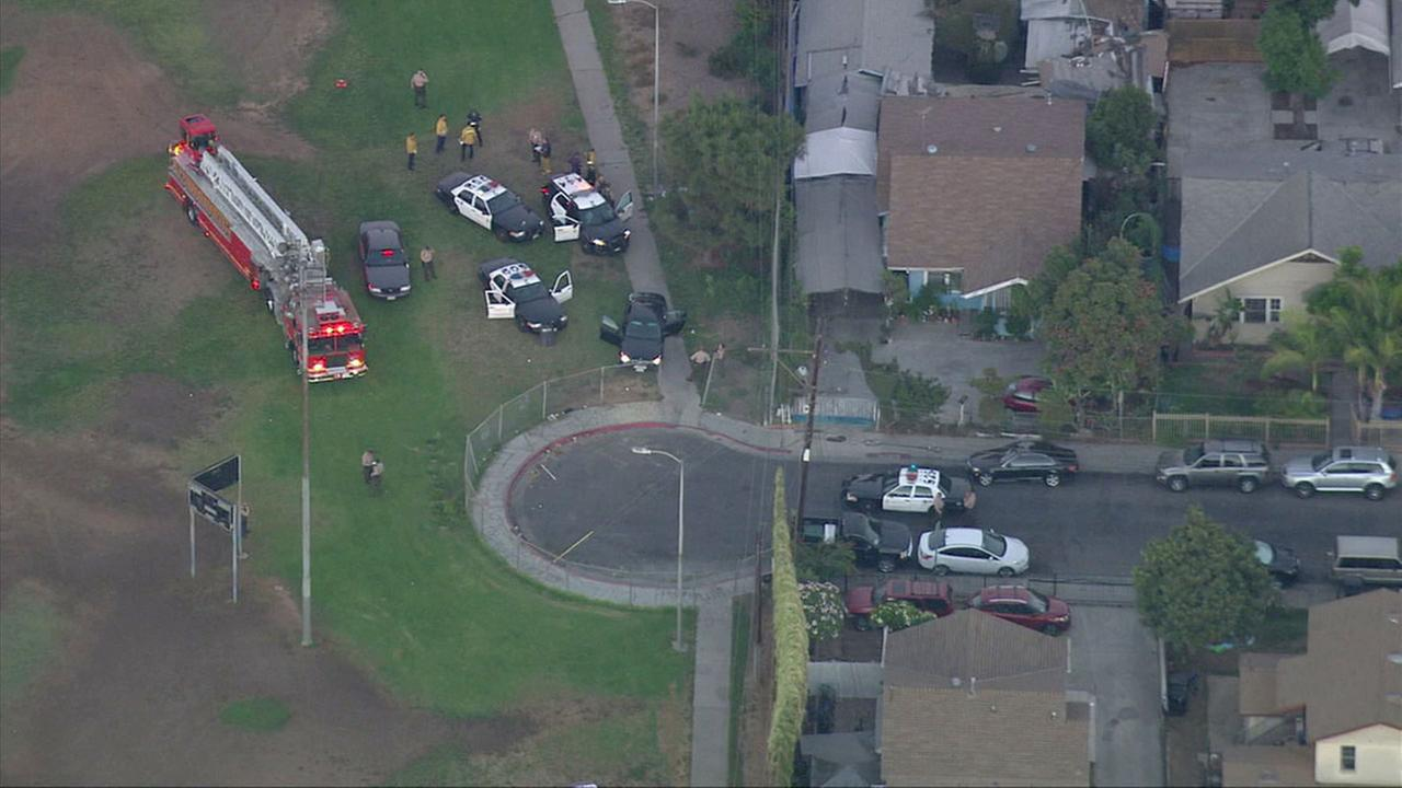 Authorities surround the scene of a deputy-involved shooting that left two L.A. County sheriffs deputies wounded at a park in East Los Angeles.