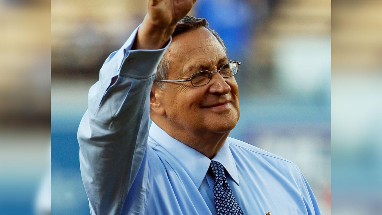 Jaime Jarrin is honored for his 54 years with the team before an interleague game against the Los Angeles Angels at Dodger Stadium in Los Angeles Monday, June 11, 2012.