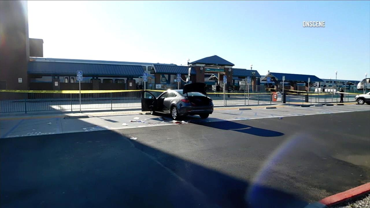 A vehicle is shown at the scene of a stabbing that left a man with a neck wound at a Metrolink station in Riverside.
