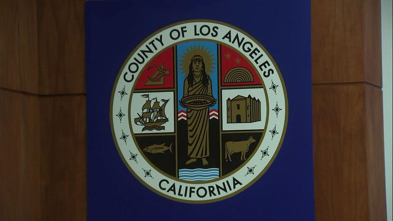 The seal for Los Angeles County is shown in an image from the board of supervisors meeting room.