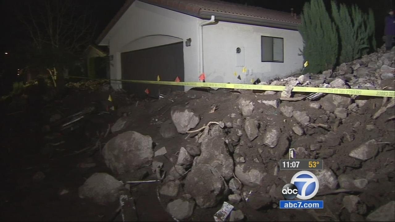 Rocks and debris surround a home after a storm swept through Camarillo Springs on Friday, Dec, 12, 2014.