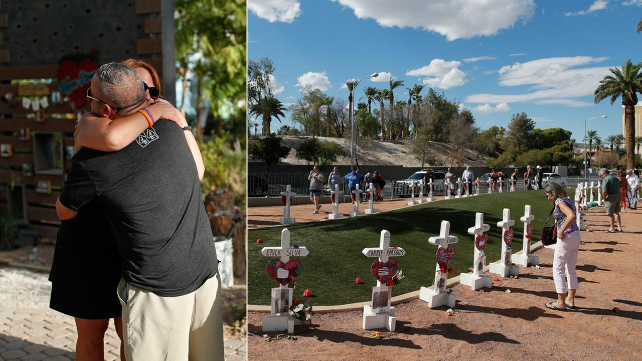 Two people embrace at a Las Vegas memorial garden Sept. 28, 2018. People visit a makeshift memorial made of crosses on Sept. 30, 2018.
