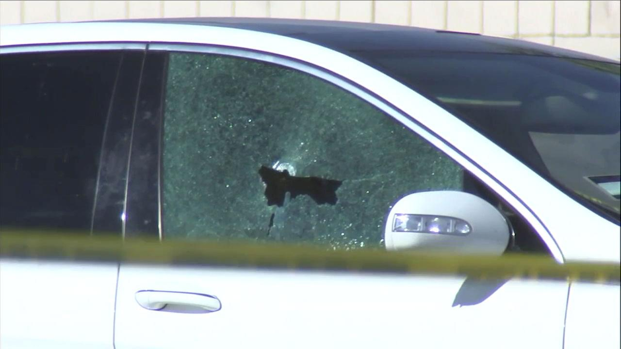 A shattered window of a Mercedes-Benz van is shown at a Victorville used car dealership.