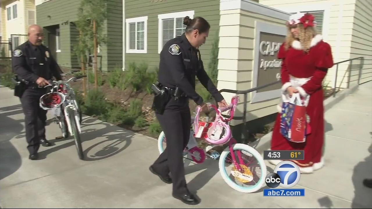 Santa Ana police brings gifts for the Sayong family on Wednesday, Dec. 17, 2014.