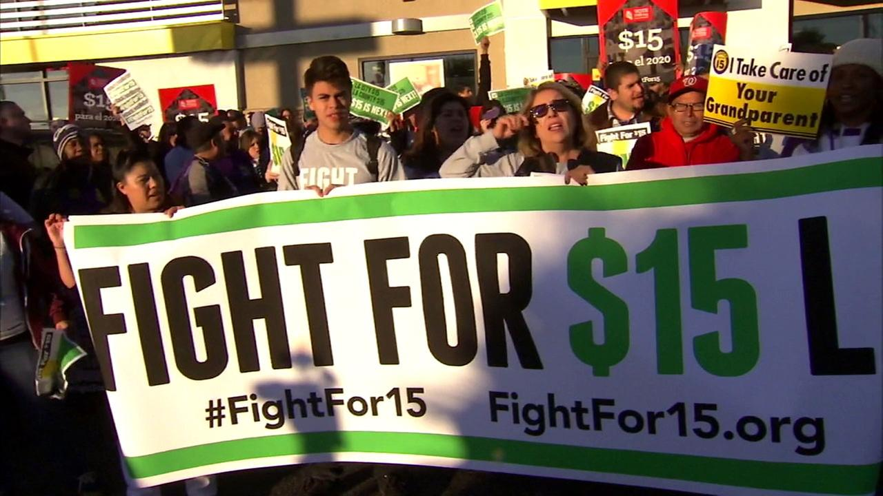 Fast-food workers rally in their fight to increase minimum wage to $15 an hour.