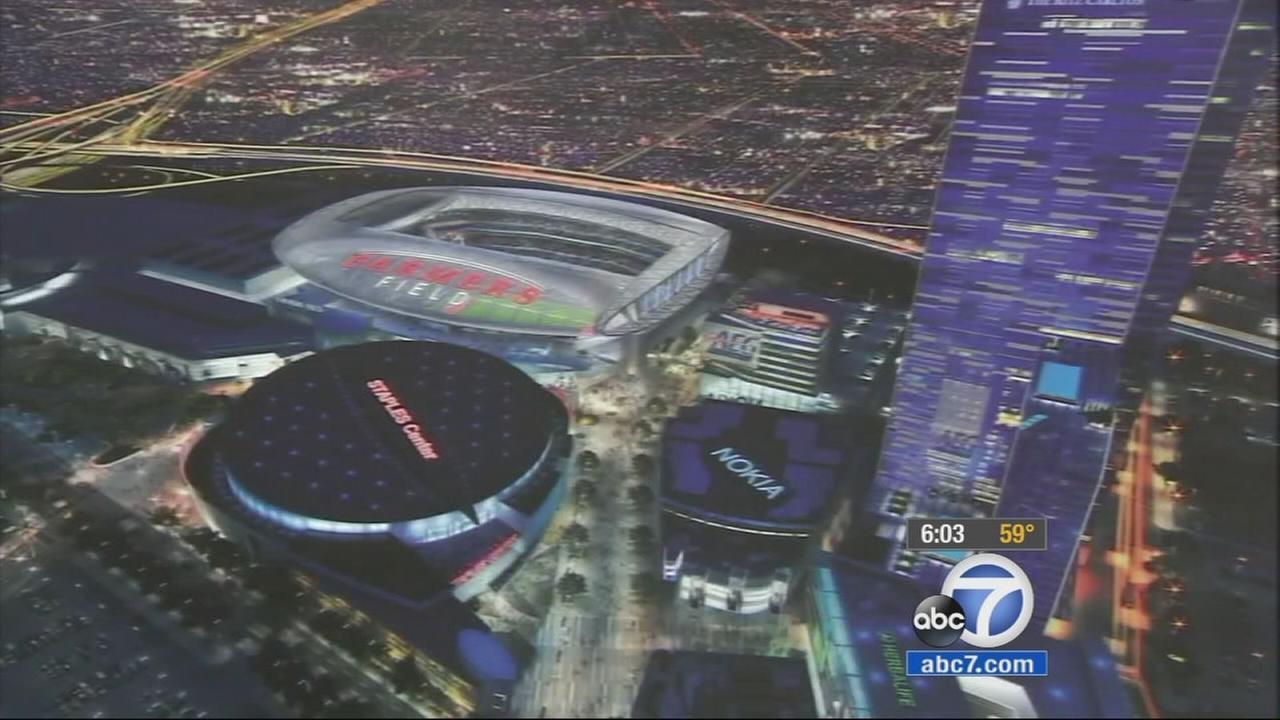 A mock-up image of the proposed NFL stadium is shown.