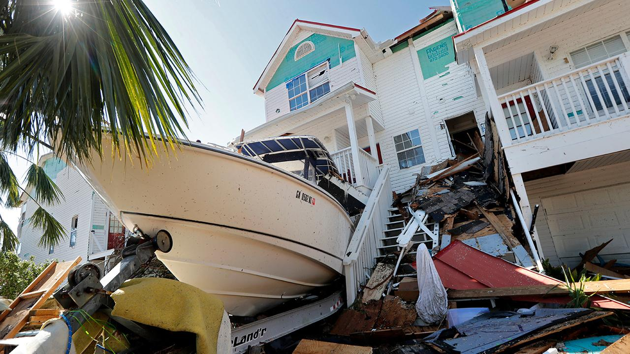 A boat sits lodged into a home in the aftermath of Hurricane Michael in Mexico Beach, Fla., Thursday, Oct. 11, 2018.