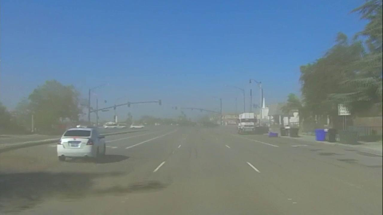 Dust blows through a street in the Inland Empire as fierce winds whip through the Southland on Monday, Oct. 15, 2018.