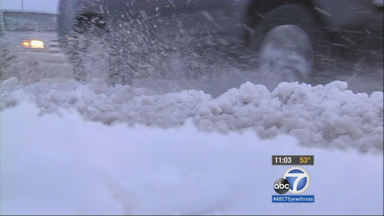 Several inches of snow covered the streets in the Inland Empire overnight and caused traffic along the 15 Freeway.
