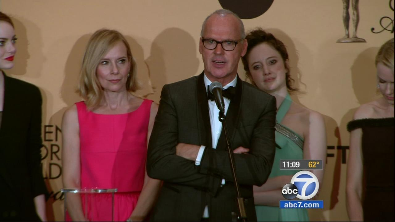 The cast of Birdman talks backstage at the Screen Actors Guild Awards on Sunday, Jan. 25, 2015.