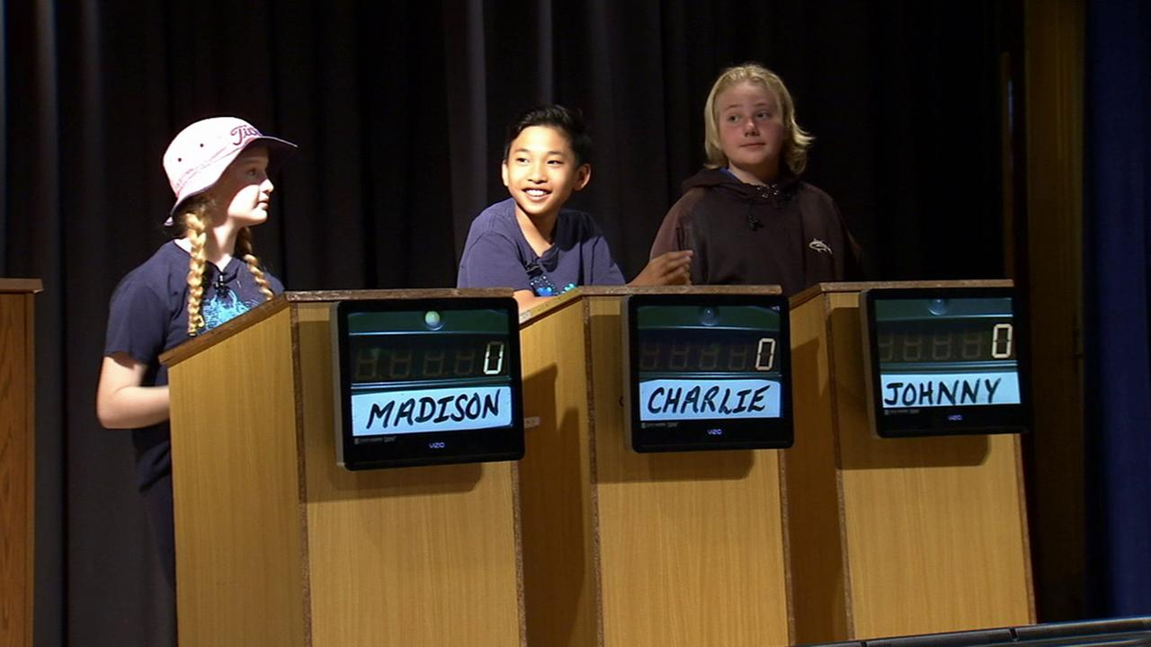 Three Cubberley Elementary School students compete to continue in the schools annual Jeopardy tournament.