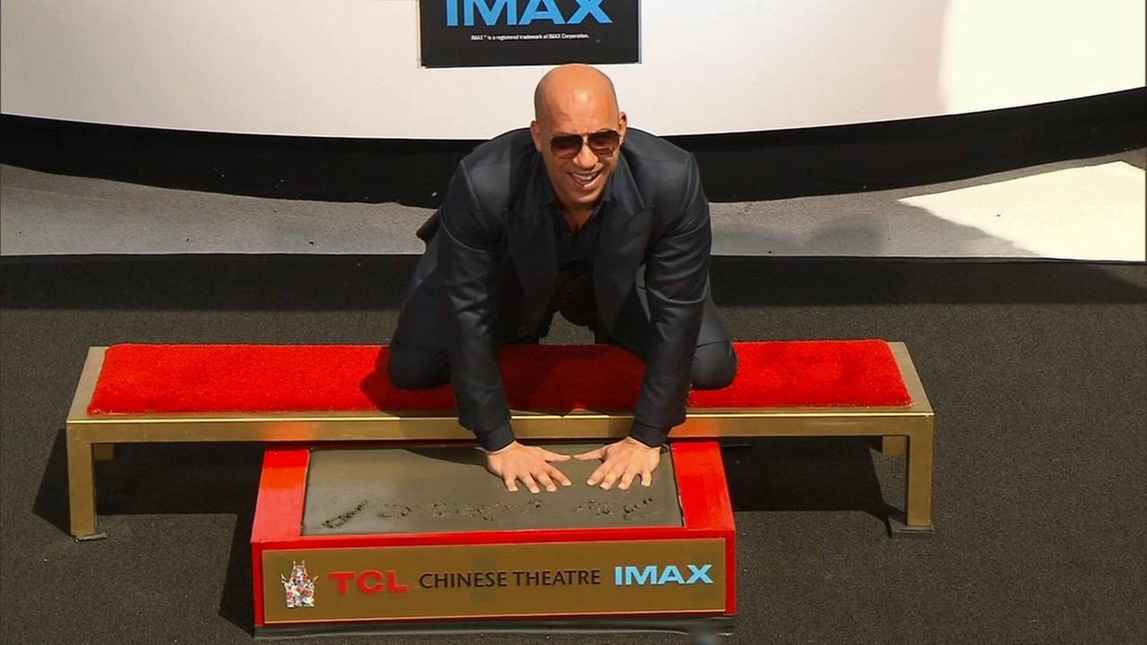 Actor and filmmaker Vin Diesel pressed his hands and feet into cement in front of the TCL Chinese Theatre in Hollywood on Wednesday, April 1, 2015.