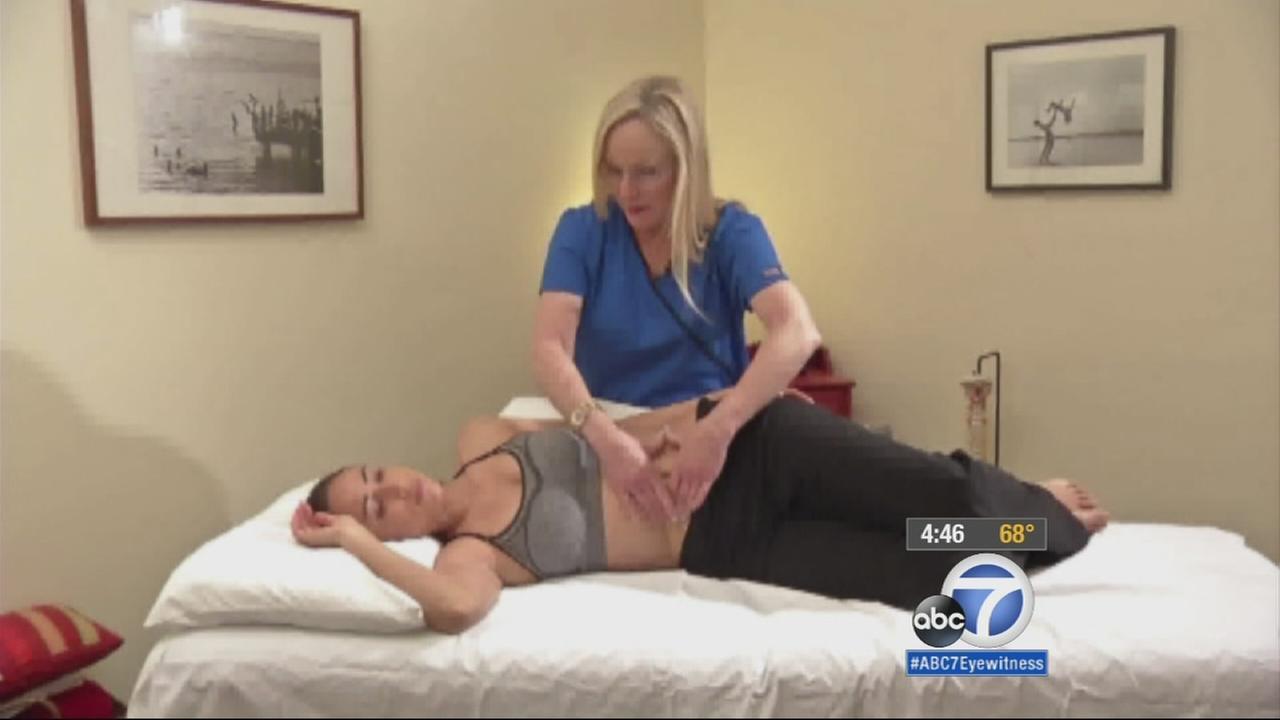 Belinda Wurns massages a patients lower abdomen to alleviate Fallopian tube blockage.