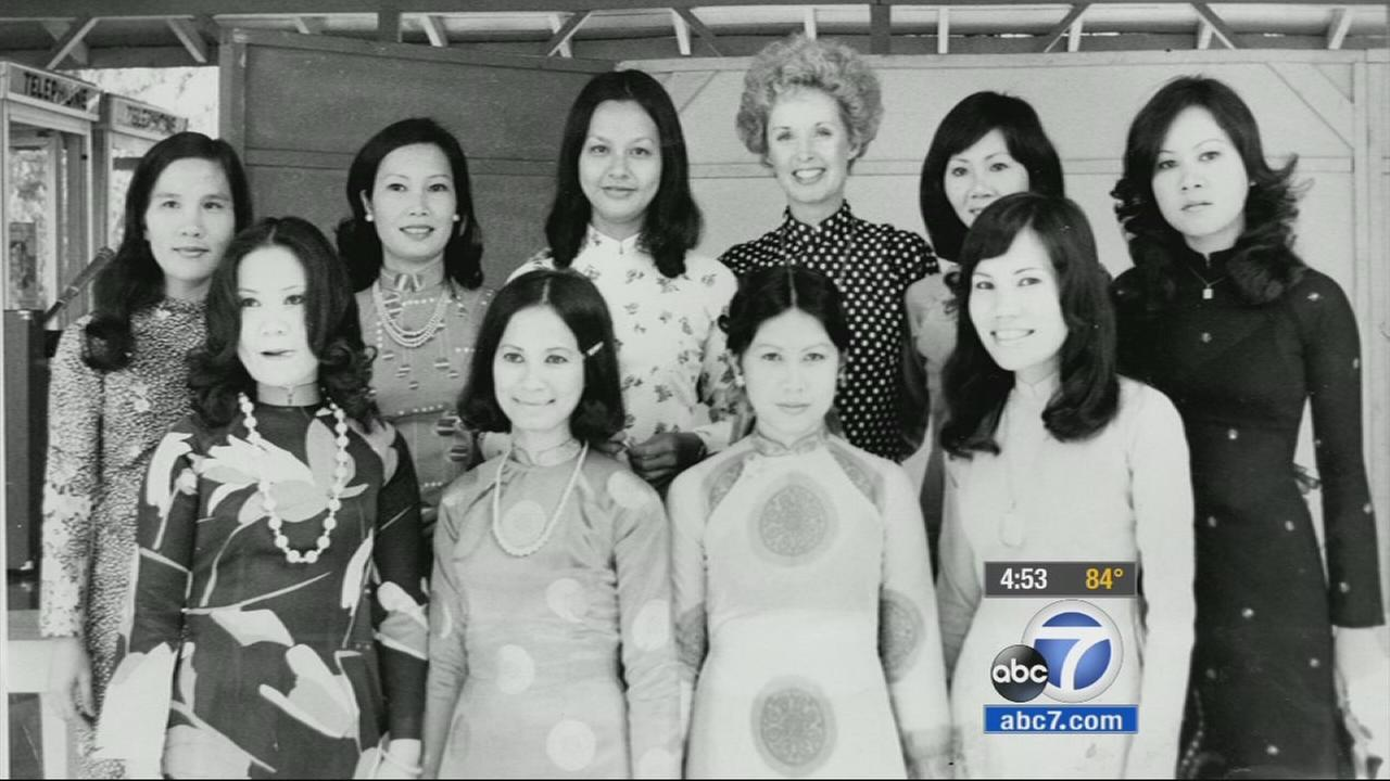 Tippi Hedren and her original class of Vietnamese manicurists pose for a photo in this undated file photo.