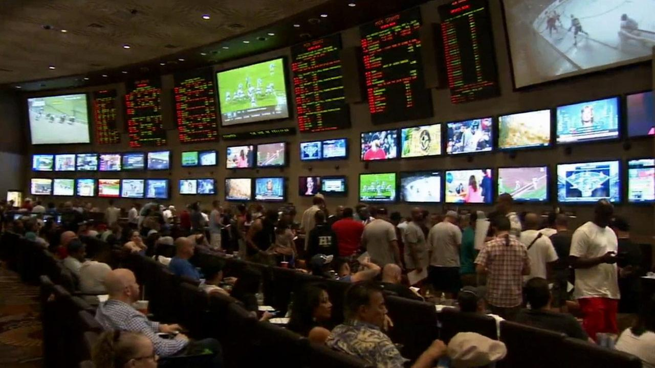People place bets on the Mayweather v. Pacquiao fight in the booking center at MGM Grand Hotel and Casino in Las Vegas on Saturday, May 2, 2015.