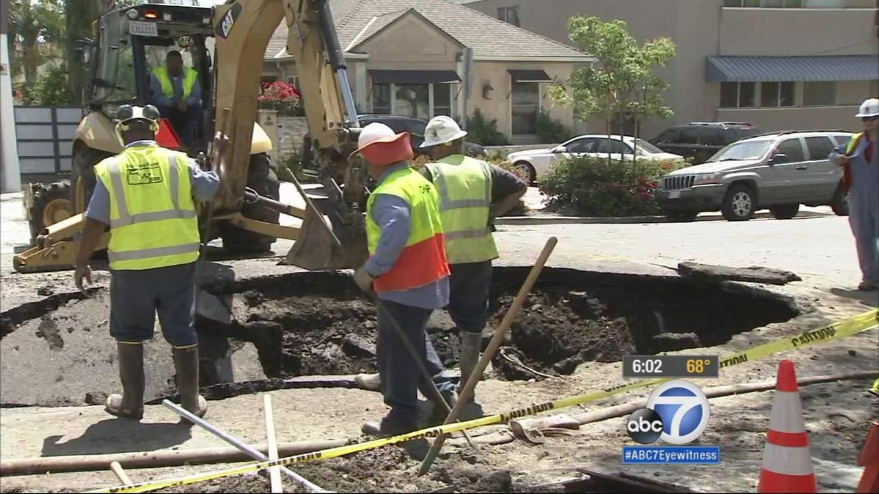 LADWP crews work to repair a water main that burst in West Hollywood on Sunday, May 10, 2015.