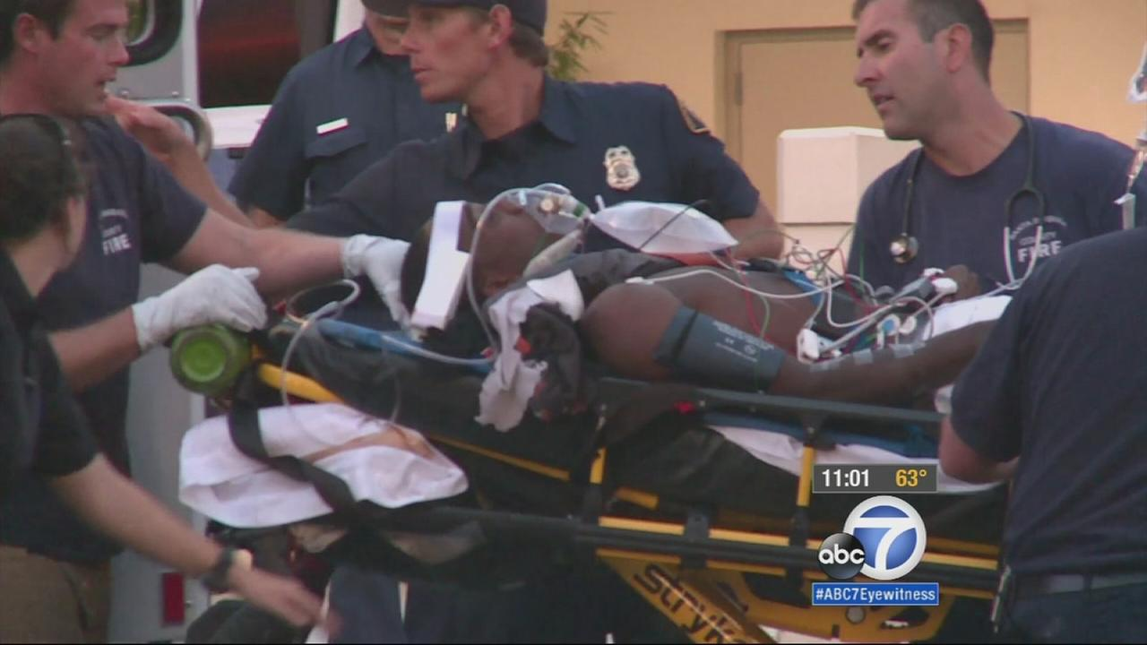 One of the victims in a shooting in Isla Vista is shown in a gurney as he is led into the hospital on Monday, May 11, 2015.