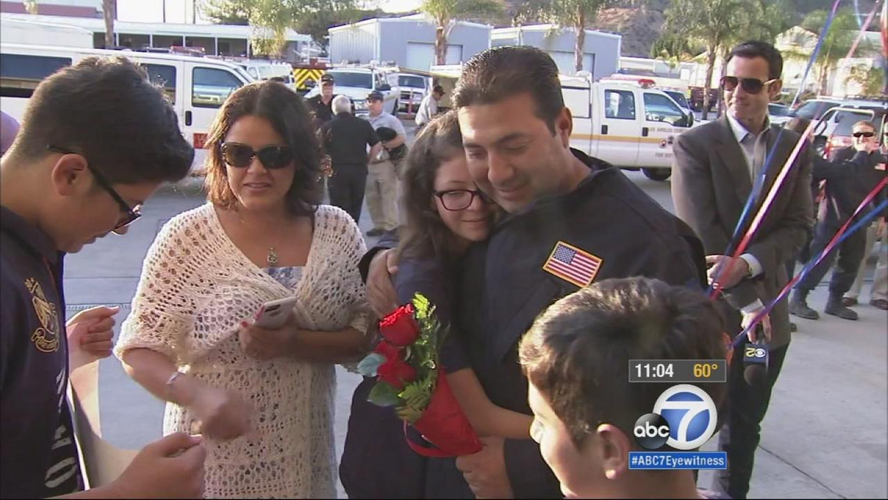 Los Angeles County Fire Departments Gerald Gonzales reunites with his family after nearly three weeks in Nepal on Friday, May 15, 2015.
