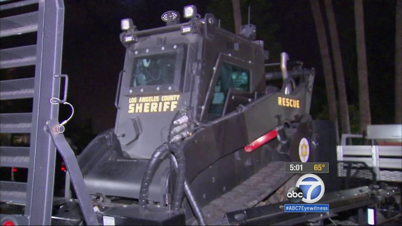 A 22-hour standoff between Los Angeles County sheriffs deputies and an armed 74-year-old woman in the middle of a mental health crisis ended peacefully.