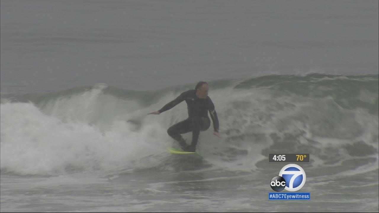 Surfers and swimmers were back in the water of Southern California beaches enjoying the waves Saturday following a three-day closure due to an oily substance.