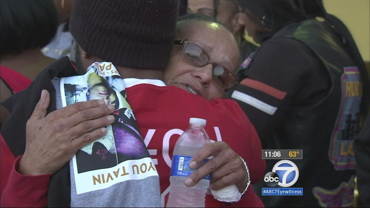 An outpouring of support showed up Friday for the family of a developmentally disabled man who was allegedly killed by gang members at a car wash in South Los Angeles because he was wearing red shoes.