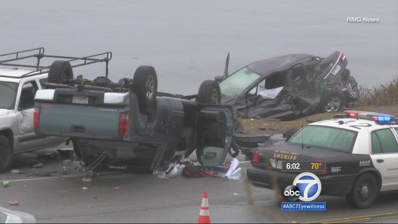 A man was killed and a woman was injured after a pickup truck smashed into them as they sat in a parked car at a beach along Pacific Coast Highway in Malibu Saturday morning.