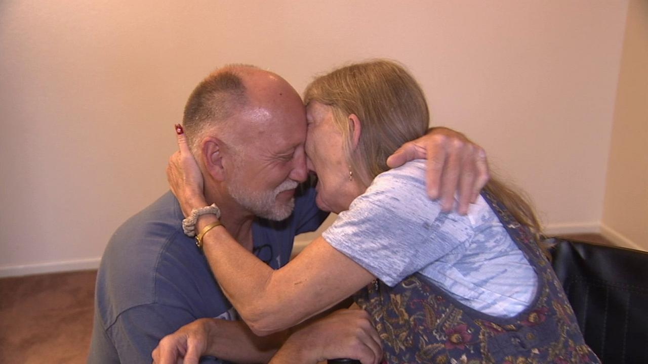 Terry Ressler and Cici Brown are shown embracing inside their new one-bedroom home in this undated photo.