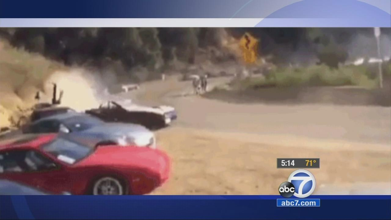 The California Highway Patrol is looking into video of a car striking two people and several other cars while drifting in Turnbull Canyon near Whittier.