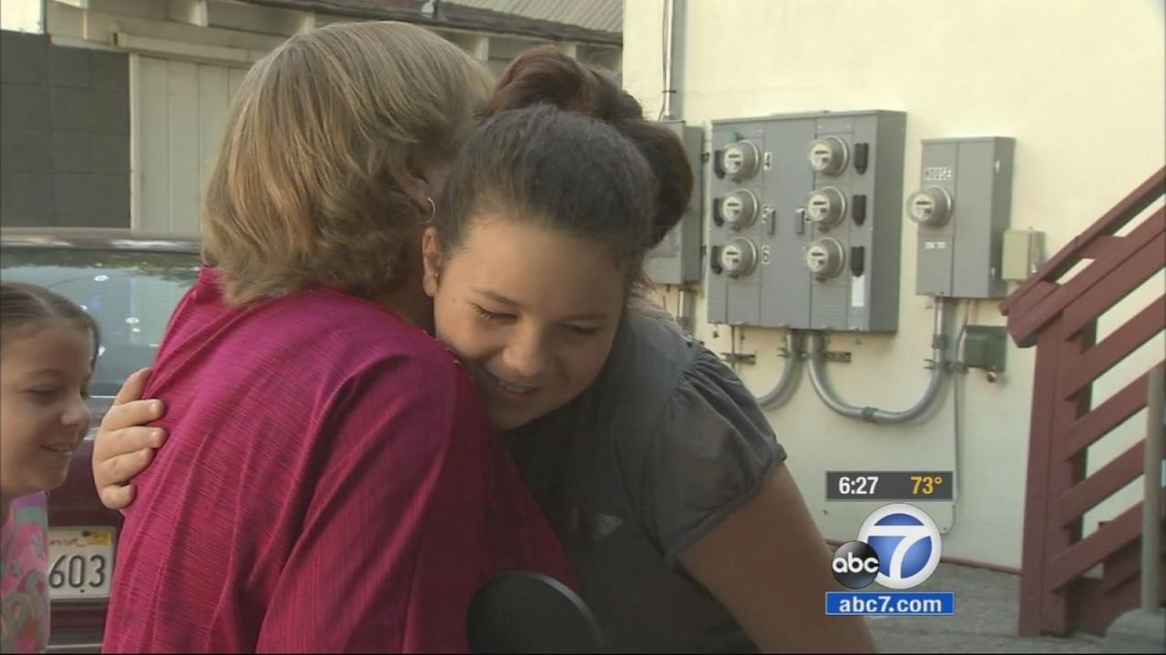 Lyndsey Pellegrini is reunited with her rescuer Becky Jefferies on Thursday, July 16, 2015.