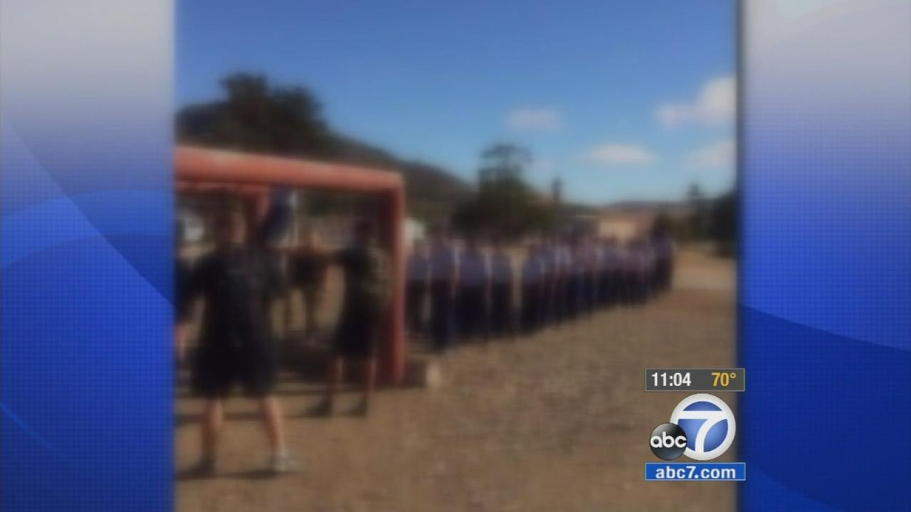 Four police officers have been arrested on suspicion of physically abusing 13 children attending a police-run boot camp in San Luis Obispo.