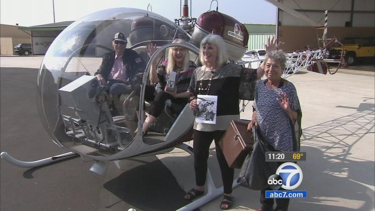 Three women, who did a daring stunt to get the Beatles attention in 1965, reunited on Friday, Aug. 21, 2015 to recreate a photo of the stunt.