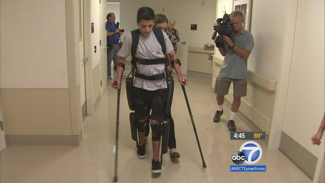 A Santa Clarita teenager who became paralyzed from the waist down in a motocross accident is getting a taste of what its like to walk again thanks to new technology.