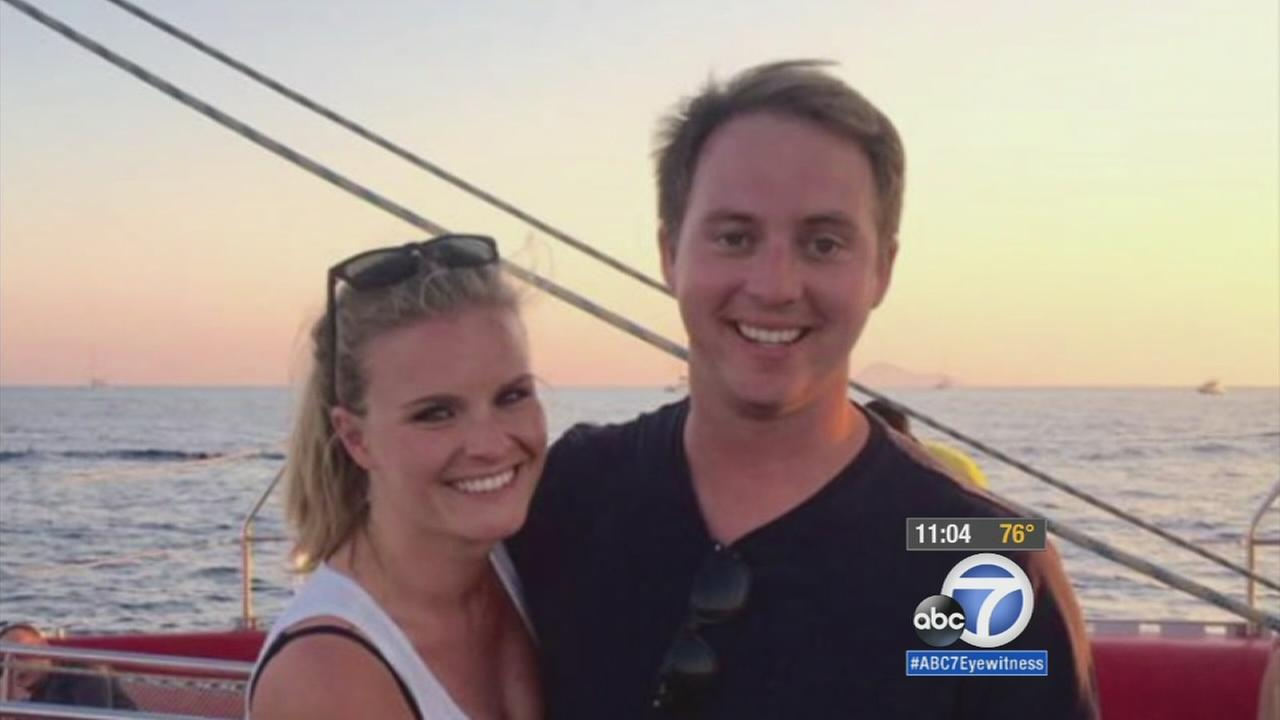 Kelly Wells, 25, is shown with her boyfriend Michael Harris, 26, in an undated photo.
