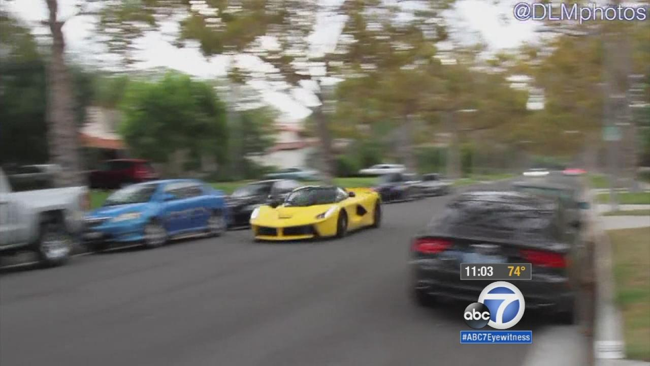 A yellow Ferrari is caught on camera racing down Walden Drive in Beverly Hills on Saturday, Sept. 12, 2015.