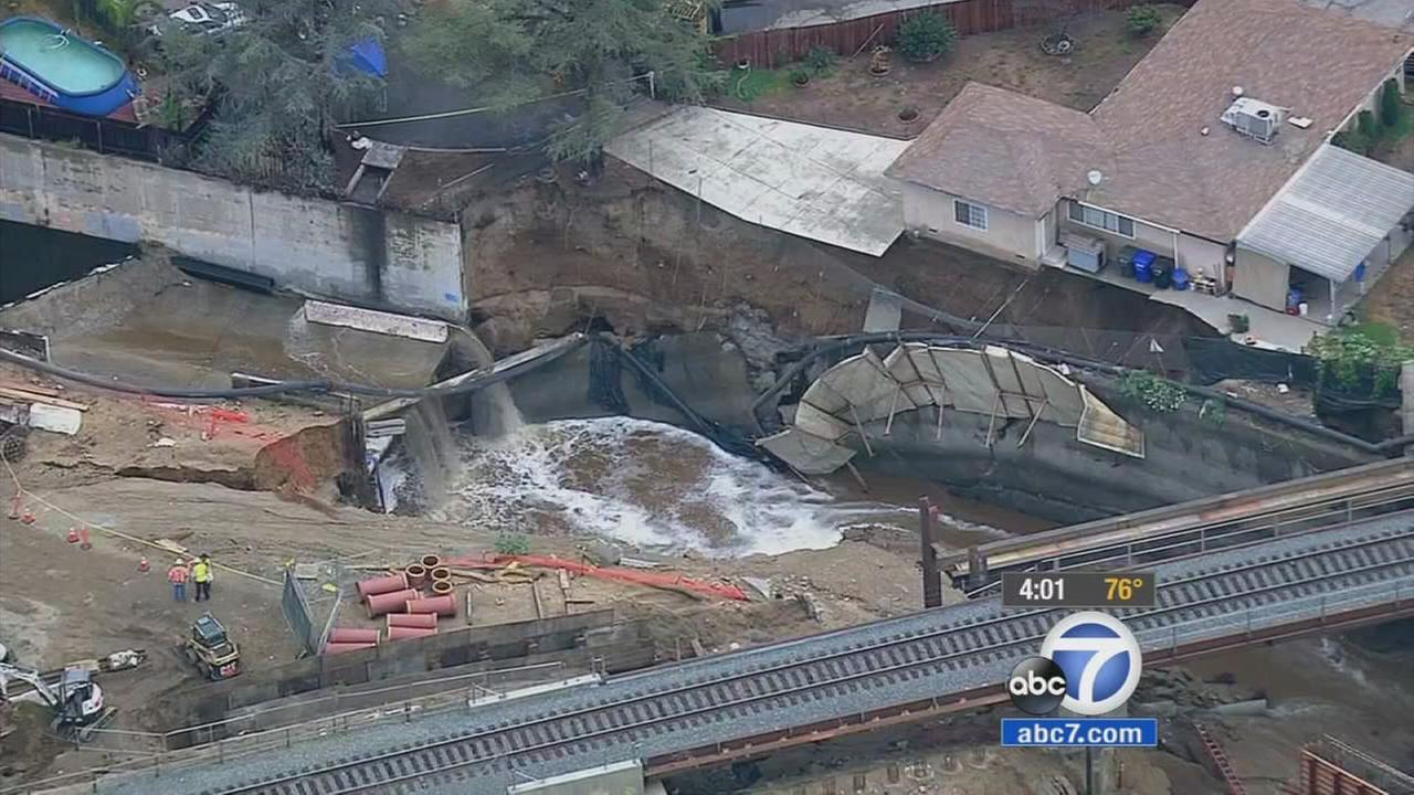 A San Gabriel home dangles over the Rubio Wash after heavy run-off waters partially eroded the foundation underneath on Tuesday, Sept. 15, 2015.