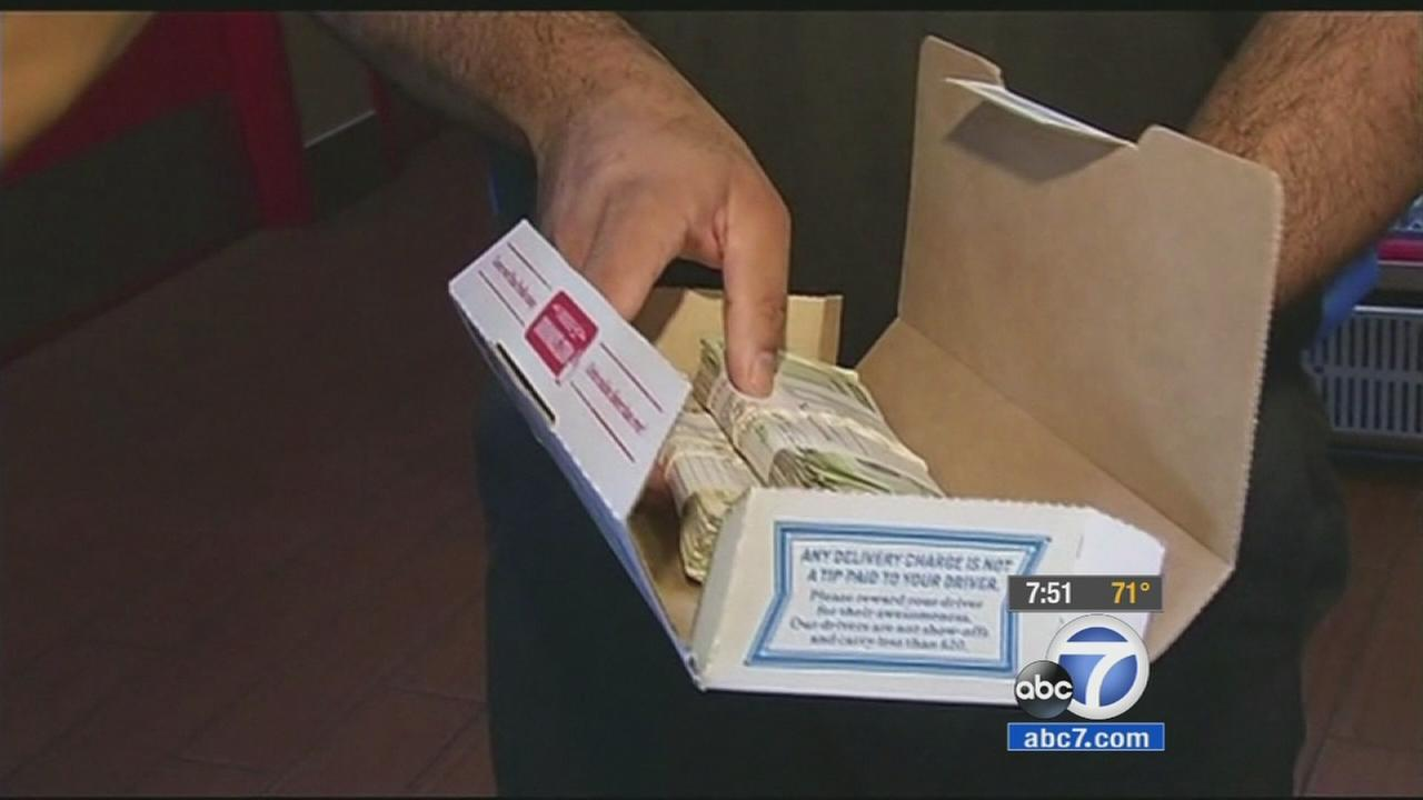 A Berkeley man returned a wad of cash accidentally delivered with his Dominos order. Now, the pizza chain is repaying him with a years worth of free pies.
