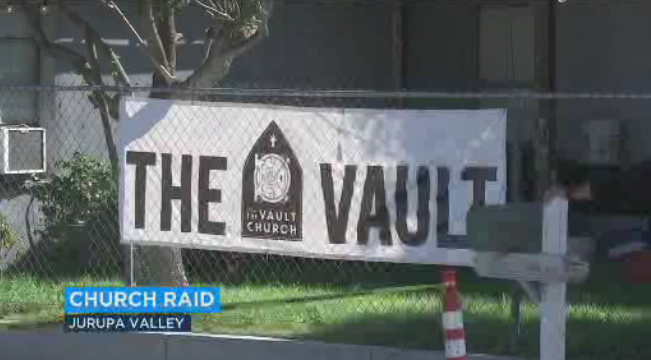 A sign for the Vault Church of Open Faith hangs outside of the building in Jurupa Valley.
