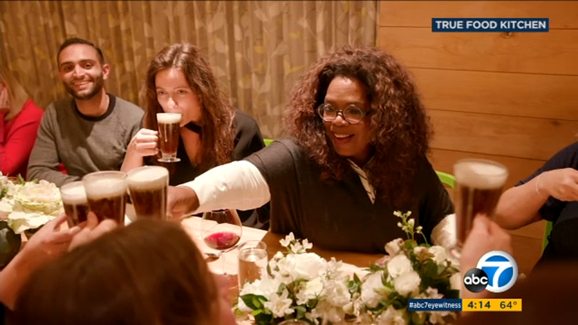 People are seen dining with Oprah at True Food Kitchen in Pasadena.