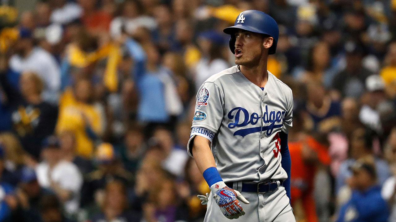 Los Angeles Dodgers Cody Bellinger walks back to the dugout after striking out during the fourth inning of Game 6 of the National League Championship Series.