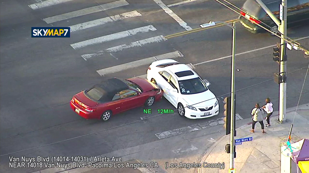 A stolen vehicle suspect rammed into another car as the driver fled police in the Pacoima area.