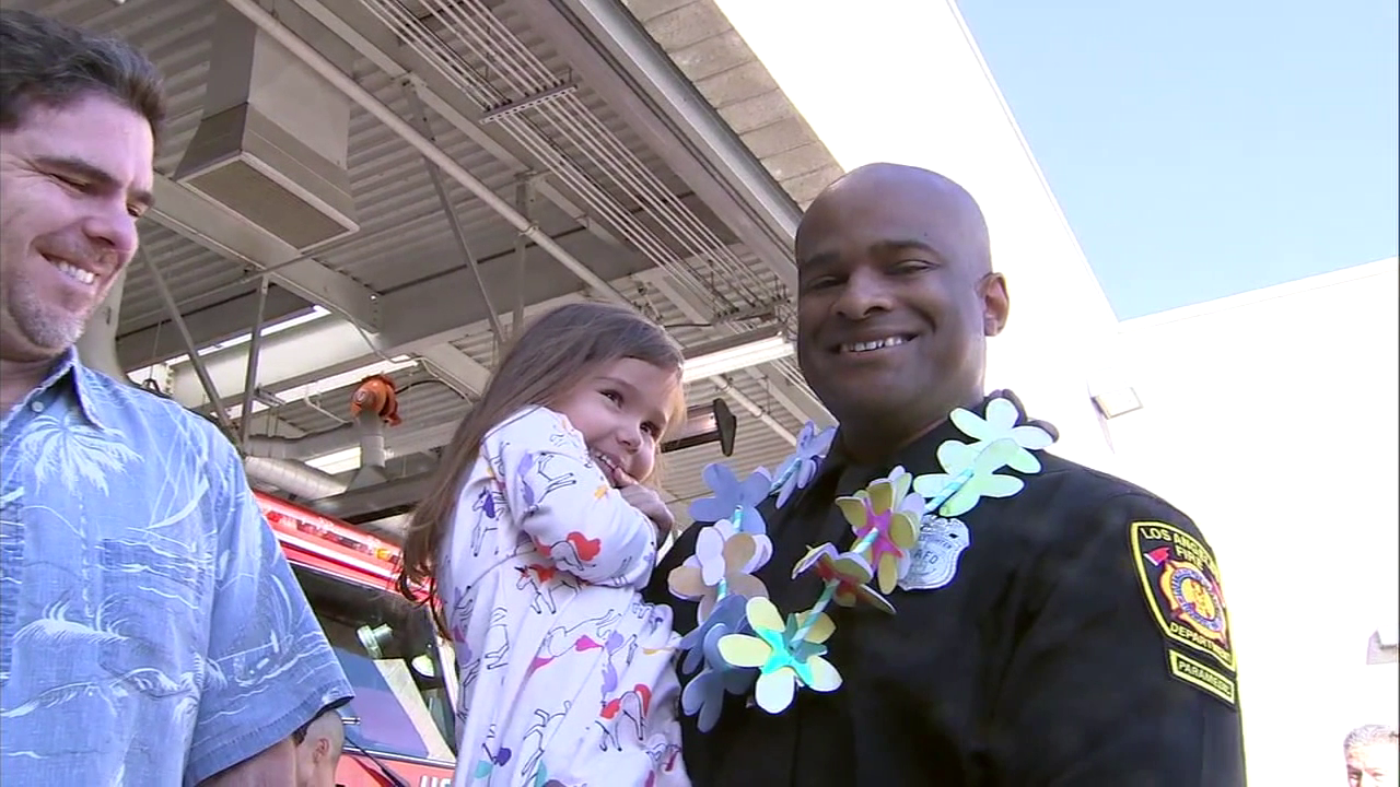 Firefighter and paramedic Daniel Harris was reunited with Sophia Rouse, a four-year-old girl he saved from drowning.