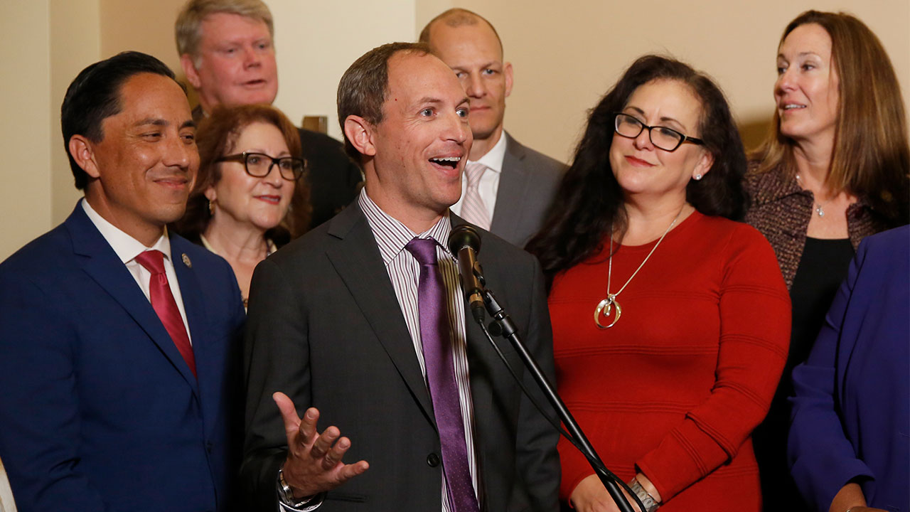 Assemblyman Brian Maienschein, center, discusses his decision to switch party registration from Republican to Democrat at a news conference while flanked by other Democrats.