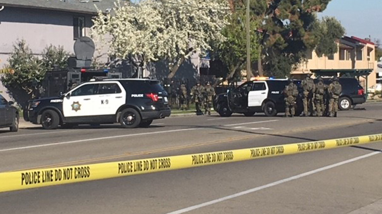 Police are serving search warrants at an apartment complex in Central Fresno that is affecting traffic in the area.
