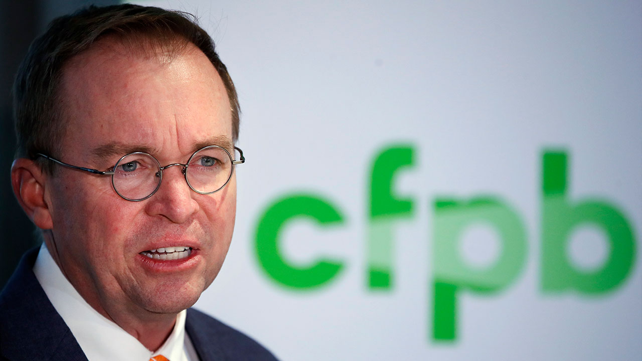 FILE - In this Nov. 27, 2017 photo, Mick Mulvaney speaks during a news conference after his first day as acting director of the Consumer Financial Protection Bureau in Washington.