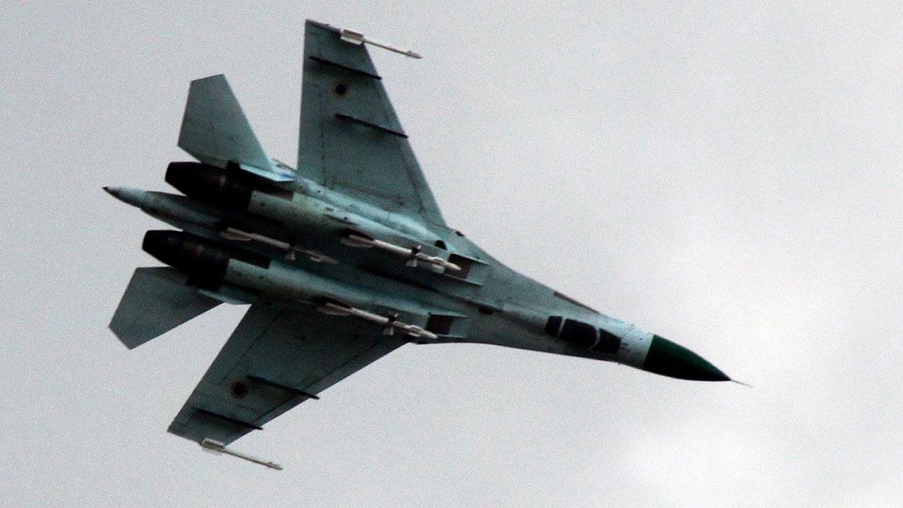 FILE - In this Tuesday, April 15, 2014 file photo, Ukrainian Air Force Su-27 fighter jet is in the skys of eastern Ukraine.