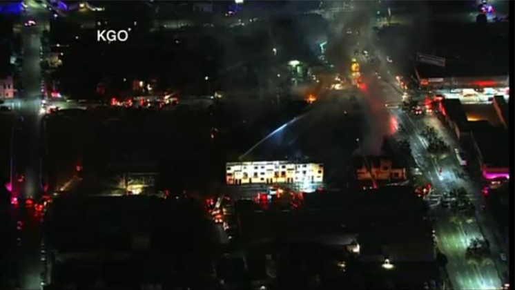 Oakland Fire crews battling intense flames from five alarm fire engulfing apartment complex
